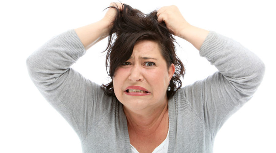 woman pulling out hair because stress leads to weight gain